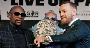 Floyd Mayweather and Conor McGregor pose with the WBC 'Money Belt' for which they will fight in Las Vegas on Saturday. Photo: John Locher/AP
