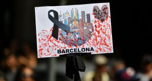 A placard with a black ribbon is brandished on Las Ramblas in Barcelona, Spain, following the recent terror attack on the street. Photograph: Pascal Guyot/AFP/Getty