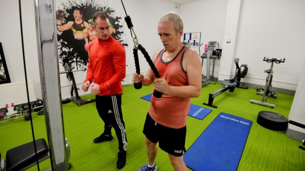 Staff member Johney Martin with Martin Reilly at the new gym. Photograph: Alan Betson