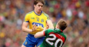 Roscommon's David Murray and Mayo's Donal Vaughan get to know each other. Photograph: Ryan Byrne/Inpho