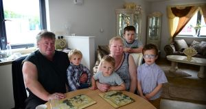 Jim and Josie Connors with their grandchildren in their new home off Glenamuck Road, Carrickmines:  Jim (3), Michael (2), Michael (8) and Tom (6).  Photograph: Bryan O'Brien