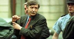 Ex-IRA member and Garda informant Sean O'Callaghan being escorted from the High Court in 1998. Photograph: Charlie Collins