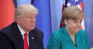 """I see no military solution for North Korea, I consider that completely wrong,"" said Dr Merkel (above, with Donald Trump). Photograph: Michael Kappeler/Reuters"