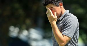 Rory McIlroy of Northern Ireland reacts after putting out on the 18th green during round one of The Northern Trust at Glen Oaks Club in Westbury, New York. Photo: Andrew Redington/Getty Images