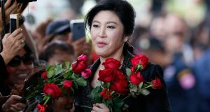 Thailand's former prime minister Yingluck Shinawatra receives flowers from her supporters on her arrival at the Supreme Court to make final statement of the hearing in Bangkok, Thailand on August 1st. Photograph: AP Photo/Sakchai Lalit