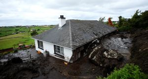 Damage caused to a house  after a landslide carrying a boulder and car came through the home during torrential rains in Urris, Co Donegal. Photograph: Clodagh Kilcoyne/Reuters