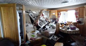 The kitchen of Bernie Kearney's destroyed home after a landslide carrying a boulder and her car (seen at the kitchen window) came through the house during torrential rains in Urris, Co Donegal. Photograph: Clodagh Kilcoyne/Reuters
