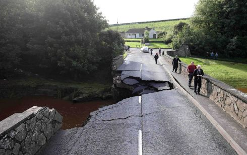 A section of road swept  away by the flooding at Claudy, Co Derry. Photograph:   Matt Mackey/Press Eye