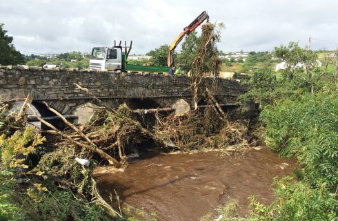 Clean up operations underway at Cockhill Bridge in Buncrana, Co Donegal, after heavy rain.  Photograph: Niall Carson/PA Wire
