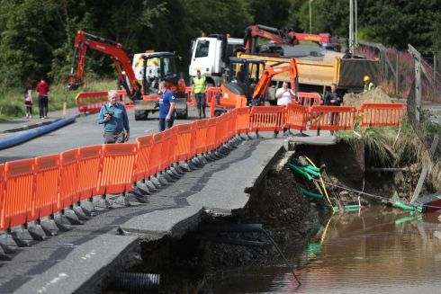 Damage to a road next to the river Faughan in Drumahoe, Derry, after heavy rain left a trail of destruction. Photograph: Niall Carson/PA Wire