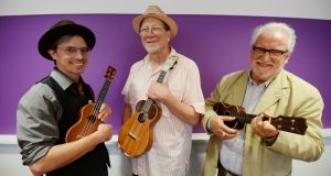 Tim Findlen and Joel Eckhaus with Tony Boland (R), director of Sunday's Ukelele Hooley in Dun Laoghaire. Photograph: Alan Betson/The Irish Times