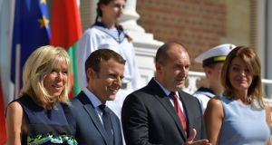 French president Emmanuel Macron stands next to his wife, Brigitte Macron, Bulgarian president Rumen Radev and his wife, Desislava Radeva. Photograph: Dimitar Dilkoff/AFP/Getty Images