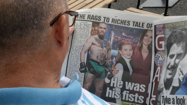A local reads the headlines. Photograph: Cyril Byrne