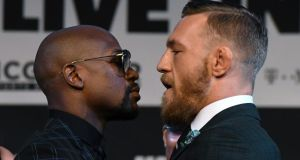 Floyd Mayweather and Conor McGregor face off during their  news conference at the KA Theatre at MGM Grand Hotel & Casino  in Las Vegas. Photograph:  Ethan Miller/Getty Images