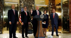 US president Donald Trump is flanked by (left to right) senior membes of his administration  Gary Cohn,  Steven Mnuchin,   Elaine Chao and  Mick Mulvaney as he gives an impromptu press conference at Trump Tower on August 15th in the wake  of the clashes in Charlottesville between white supremacists and opponents, in which a young woman was killed.  Photograph: Kevin Lamarque/Reuters