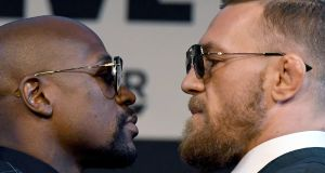 Floyd Mayweather  and  Conor McGregor face off during a news conference at the KA Theatre at MGM Grand Hotel & Casino  in Las Vegas ahead of their  super welterweight fight on Saturday. Photograph:   Ethan Miller/Getty Images