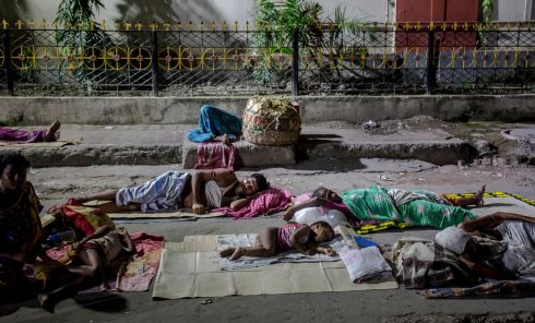 SLEEPING ROUGH: Homeless families sleep in an open area near a railway station in Calcutta, eastern India. According to governmental reports, some 78 million homeless people survive every day on the streets, sleeping on railway platforms, under flyovers or elsewhere in the open in India. Photograph: Piyal Adhikary/EPA
