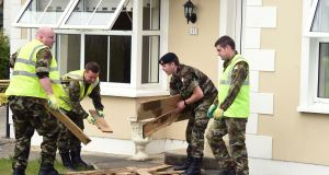 Irish Army help in clean-up at Buncrana in Donegal. Photograph: Trevor McBride