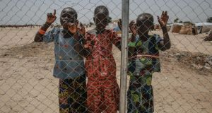 Young girls stand by a fence in Muna camp for displaced people in Maiduguri, northeast Nigeria. Photograph: Sally Hayden