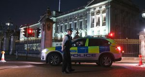 Three police officers were injured after tackling a man who drove a blue Toyota Prius at a marked police vehicle outside Buckingham Palace (above) in London on Friday night. Photograph: GOR/Getty Images