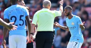 Manchester City's  Raheem Sterling reacts after being sent off by referee  Mike Dean after  receiving  a second yellow card for going into the crowd to celebrating his injury-time goal against Bournemouth. Photograph:  Glyn Kirk/AFP/Getty Images