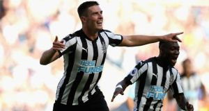 Ciaran Clark of Newcastle United celebrates scoring his side's second goal during the Premier League match against West Ham United at St James' Park. Photograpgh: Jan Kruger/Getty Images