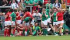 Ireland's players react after Wales' Carys Phillips scores a try. Photograph: Billy Stickland/Inpho