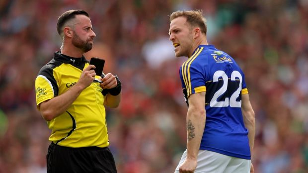 Darran O'Sullivan argues with referee David Gough after being black carded. Photograph: James Crombie/Inpho