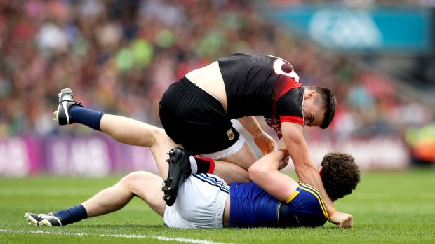 Mayo's Jason Doherty and Tadhg Morley of Kerry clash at the start of the game. Photograph: Ryan Byrne/Inpho