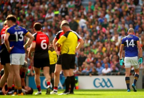 Kerry's Kieran Donaghy is red carded by referee David Gough after striking Aidan O'Shea. Photograph: James Crombie/Inpho