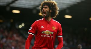 Manchester United's Marouane Fellaini celebrates scoring his side's second goal during the Premier League match against Leicester City at Old Trafford. Photograph: Dave Thompson/PA Wire