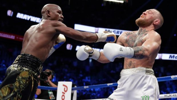 Floyd Mayweather catches Conor McGregor with a right hand during their bout in Las Vegas. Photo: Isaac Bracken/AP