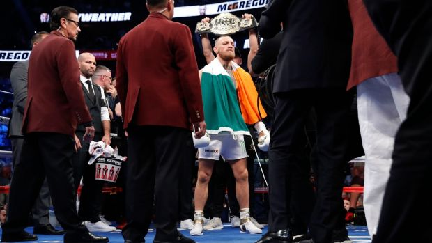 McGregor stands in the ring before the fight. Photo: Steve Marcus/Reuters