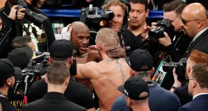Floyd Mayweather embraces Conor McGregor after their super welterweight bout in Las Vegas. Photo: Eric Jamison/AP Photo