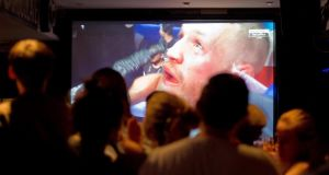 Fans  watch the live coverage of the Conor McGregor V Floyd Mayweather boxing match from Las Vegas in a Dublin city pub. Photograph: Tom Honan