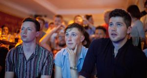Left to right:  Thomas Sammon from Letterkenny Co Donegal; Aaron Murray from Longwood, Co Meath; and Jack Cody from Dublin watch the Conor McGregor vs Floyd Mayweather match in a Dublin city pub. Photograph: Tom Honan.