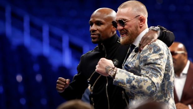 Mayweather and McGregor pose together at the post-fight press conference. Photo: Steve Marcus/Reuters