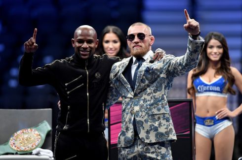 Floyd Mayweather Jr. and Conor McGregor pose for pictures after Mayweather's 10th round TKO victory in their super welterweight boxing match on August 26, 2017  in Las Vegas, Nevada.  Photo by Ethan Miller/Getty Images