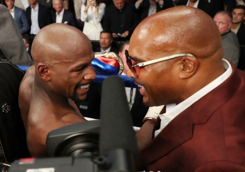 LAS VEGAS, NV - AUGUST 26:  (L-R) Floyd Mayweather Jr. hugs Mayweather Floyd Mayweather Jr. hugs Mayweather Promotions CEO Leonard Ellerbe after defeating Conor McGregor by TKO in Las Vegas, Nevada.  Photo by Christian Petersen/Getty Images  CEO Leonard Ellerbe after defeating Conor McGregor by TKO in the 10th round during their super welterweight boxing match on August 26, 2017 at T-Mobile Arena in Las Vegas, Nevada.  (Photo by Christian Petersen/Getty Images)