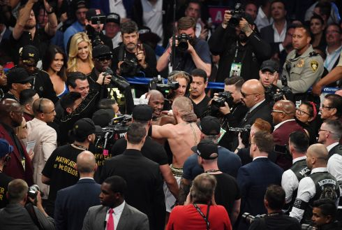 Floyd Mayweather Jr. and Conor McGregor speak following Mayweather's 10th round TKO of McGregor in Las Vegas, Nevada.  Photo by Ethan Miller/Getty Images