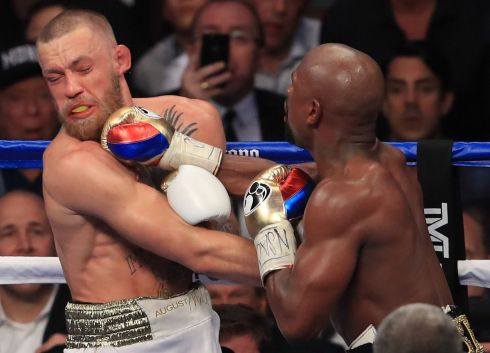Floyd Mayweather Jr. throws a punch at Conor McGregor during their super welterweight boxing match in Las Vegas, Nevada.  Photo by Sean M. Haffey/Getty Images
