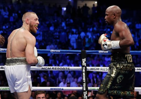 Conor McGregor sticks his tongue out at Floyd Mayweather Jr. in a super welterweight boxing match in Las Vegas. (AP Photo/Isaac Brekken)