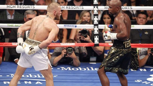 Conor McGregor in action against Floyd Mayweather. Photograph: Derek Hogan/Inpho