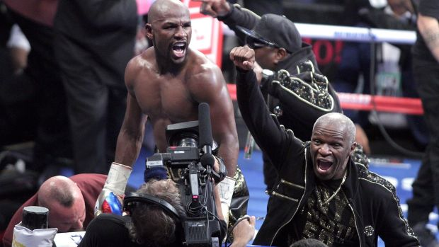 Floyd Mayweather Jr and his father Floyd Mayweather Sr celebrate his victory. Photograph: John Gurzinski/Getty Images