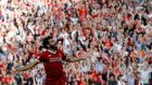 Liverpool's Mohamed Salah celebrates scoring their third goal. Photograph:  Phil Noble/Reuters