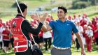 US golfer Julian Suri  celebrates winning the Made in Denmark tournament with his caddie. Photograph: Henning Bagger/AFP/Getty Images