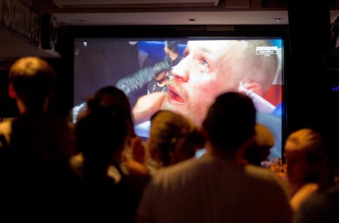UP ALL FIGHT-NIGHT: Fans of Irish fighter Conor McGregor watch live coverage of his encounter with Floyd Mayweather from Las Vegas, in a Dublin city pub. Photograph: Tom Honan