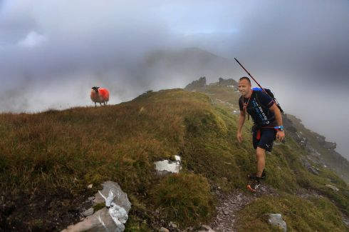 ULTIMATE HIGH PEAKS: Aidan Cleary wears his Mayo county colours on Cnoc na Péiste mountain while taking part in Killarney's Ultimate High Peaks Challenge in the MacGillycuddy's Reeks, Co Kerry. Photograph: Valerie O'Sullivan