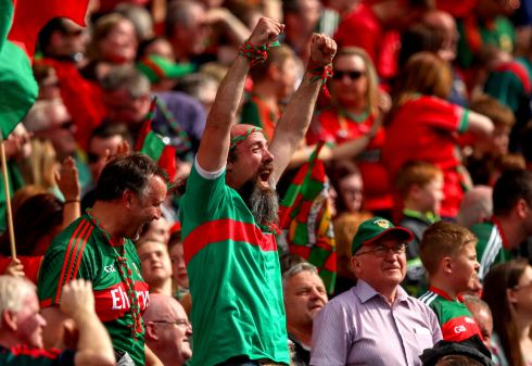 ALL-IRELAND DREAMS: Mayo supporters celebrate their side's win in the All-Ireland Senior Football Championship semi-final replay against Kerry at Croke Park, Dublin. Photograph: James Crombie/Inpho