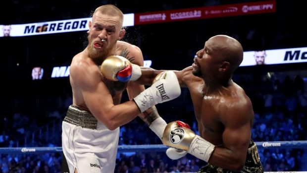 Mayweather catches McGregor with a right-hand. Photo: Christian Petersen/Getty Images